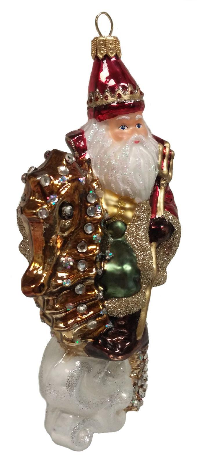 Santa claus riding on a seahorse polish glass christmas